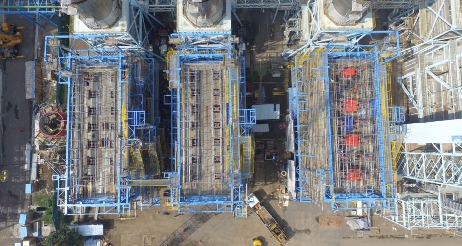Package 1 - Bird-eye view of all three units of boiler, MegaRig equipment - that was painted red - can be clearly seen at the far right. (1/6)